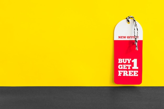Paper with buy one get one free inscription Free Photo