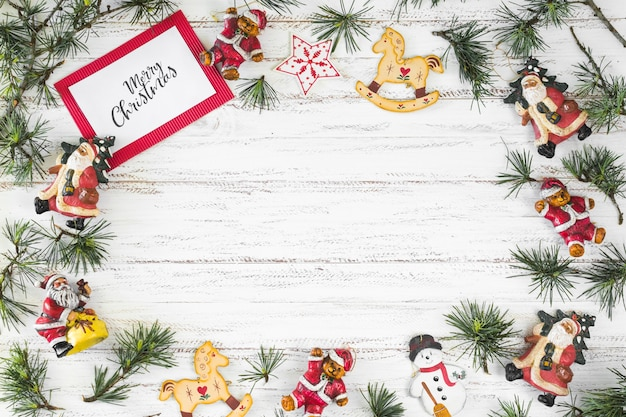 Paper with merry christmas inscription with toys Free Photo