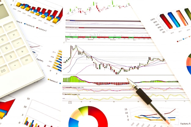 Paperwork with colorful graphs Free Photo