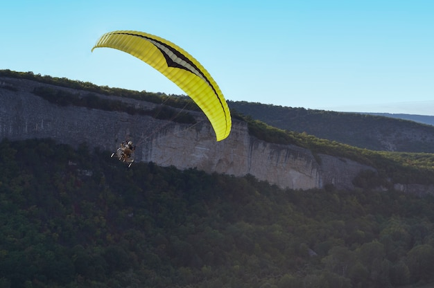 Paraglider flying over mountains Premium Photo
