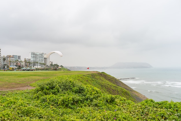 Paraglider launching from the coastline in lima miraflores Premium Photo