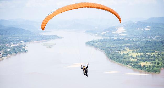 Paragliding in beautiful mountains with river at pha tak suea, amphur sungkom, nongkhai, thailand Premium Photo