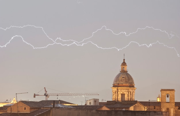 Parallel lightning over urban houses Premium Photo