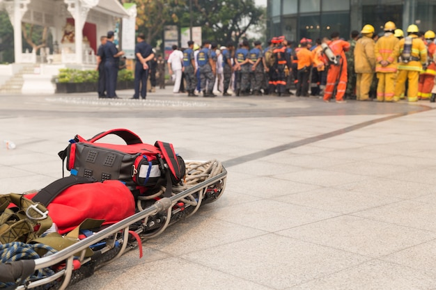 Paramedic and stretcher gurney in mock disaster drill Premium Photo