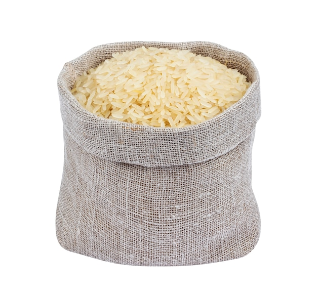 Parboiled rice in burlap bag isolated on white Premium Photo