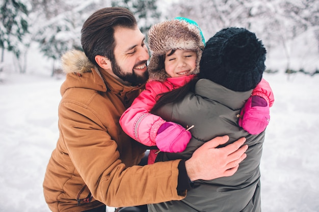 Premium Photo Parenthood Fashion Season And People Concept Happy Family With Child In Winter Clothes Outdoors