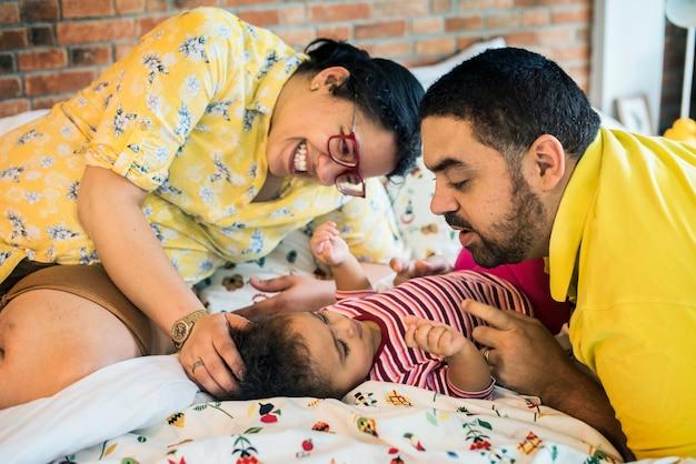 Parents take care of their kid family Premium Photo