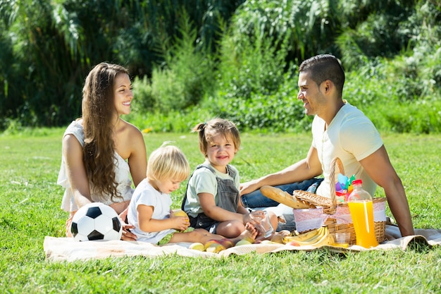 Parents with  daughters having  picnic Free Photo