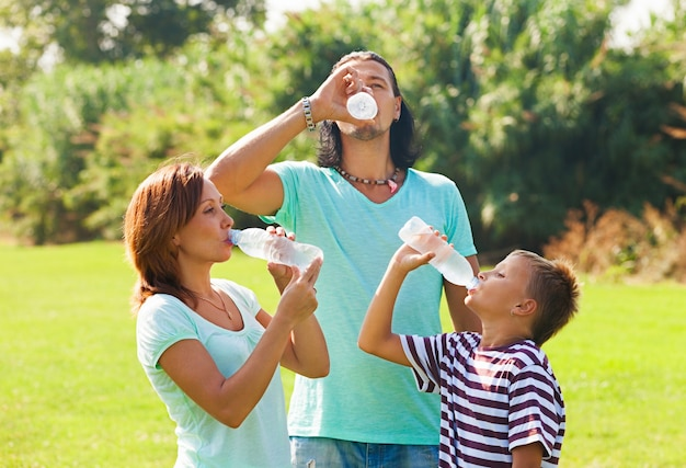 Parents with teenager drinking water Free Photo
