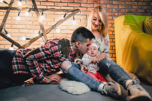 Parents with their child on the background of a star with bulbs Premium Photo