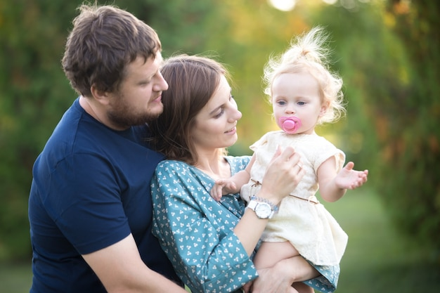 Parents with toddler daughter in park Free Photo