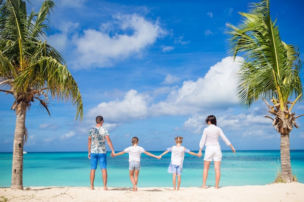 Parents with two kids enjoy their caribbean vacation on antigua island Premium Photo