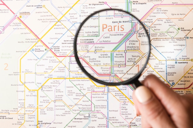 Paris metro map with magnifying glass Free Photo