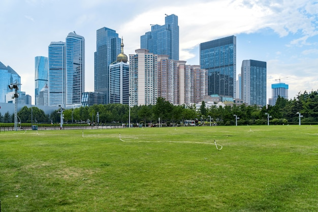 Park lawn and modern urban architecture in qingdao, china Premium Photo