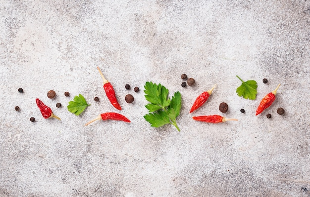 Parsley, red chili and black pepper on light background Premium Photo