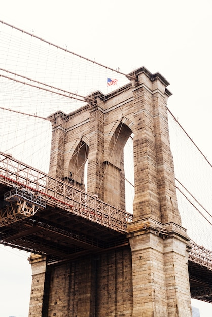 Part of brooklyn bridge in cloudy weather Free Photo