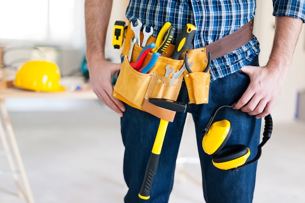 Part of construction worker with tools belt Free Photo