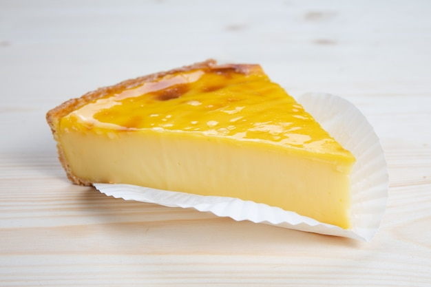 Part of pastry flan on wooden table Premium Photo