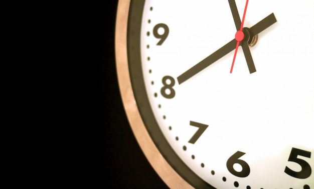 Part of wall-hanging clock at almost 8 o'clock Premium Photo