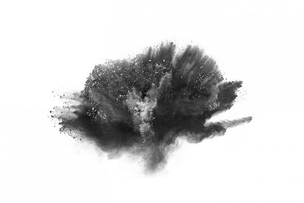 Particles of charcoal on white background. Premium Photo