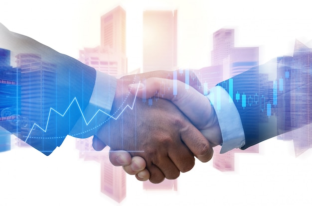 Partner. investor business man handshake with partner for successful project meeting with graph chart stock market Premium Photo