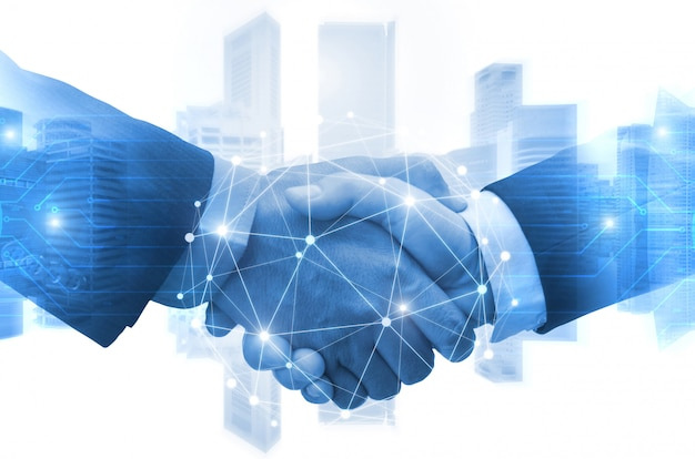 Partnership - business man shaking hands with effect digital network link connection graphic diagram, digital global technology with cityscape background Premium Photo