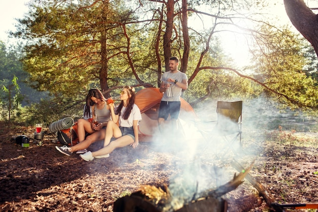 Party, camping of men and women group at forest. they relaxing Free Photo