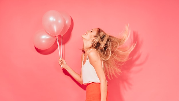 Party girl posing with balloons Free Photo