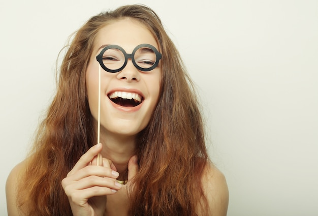 Party image. playful young women holding a party glasses. Premium Photo
