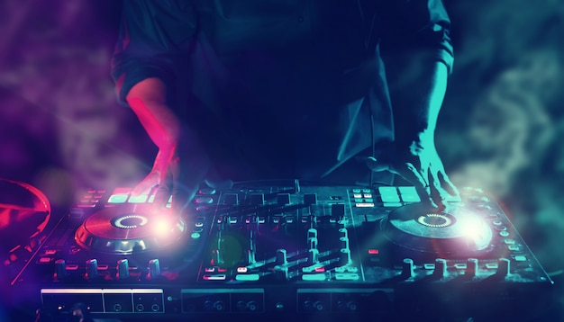 Party night club disc dj entertainment with edm dance music mixer  players with lighting e Premium Photo