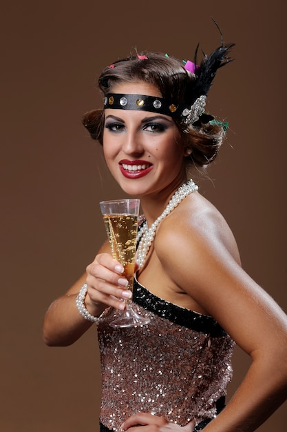Party woman hands of  one's glass wine with brown background Free Photo