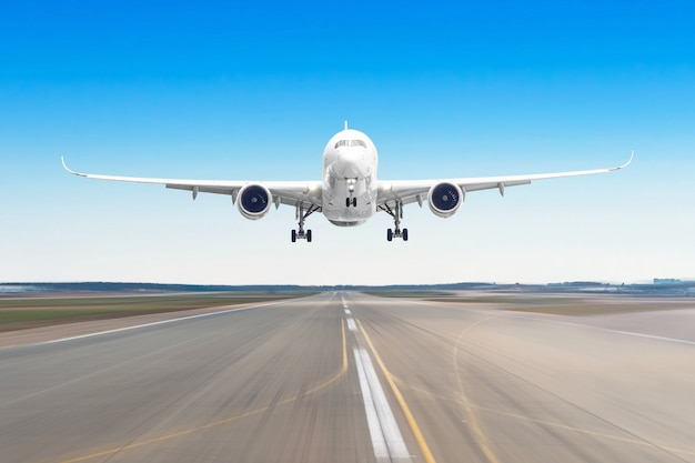 Passenger aircraft with on the asphalt landing on a runway airport, motion blur. Premium Photo