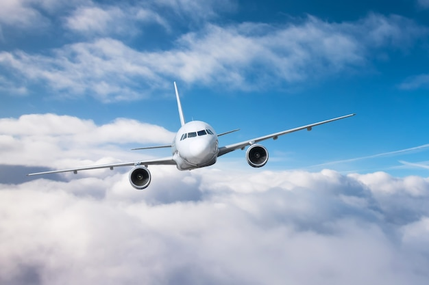 Passenger airplane climb altitude and low flying overcast. Premium Photo