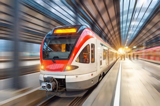 Passenger high speed train with motion blur in station. Premium Photo
