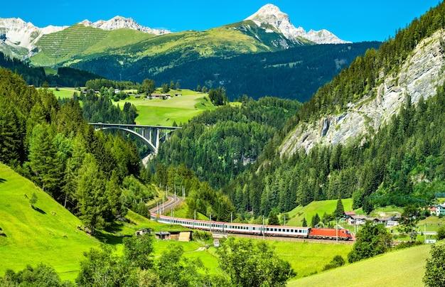 Passenger train at the brenner railway in the austrian alps Premium Photo
