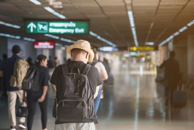 A Passenger With Straw Hat At The Departure Zone In The Airport Premium Photo