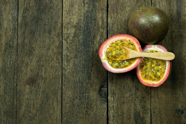 Passion fruit on wood table copyspace Premium Photo