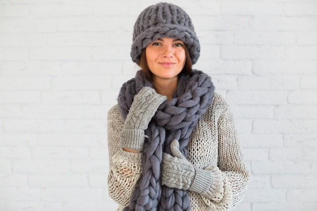 Passionate lady in mittens, hat and scarf Free Photo