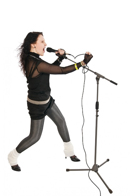 Passionate singer with microphone Free Photo