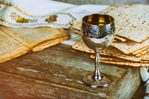 Passover holiday with wine and matzoh over rustic background with copy space Premium Photo