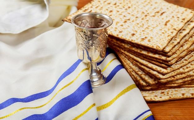 Passover matzoh jewish holiday bread and wine wooden board. Premium Photo