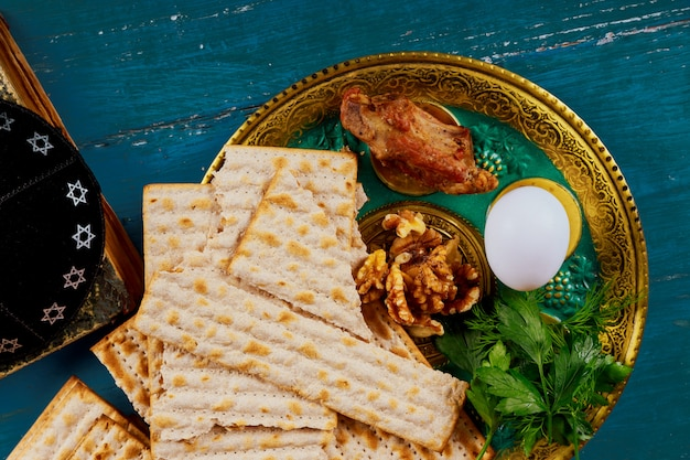 Passover matzoh jewish holiday bread over wooden table. Premium Photo