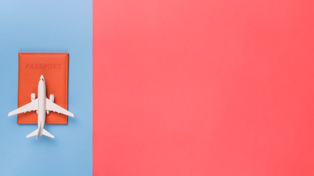 Passport and airplane on different color background Free Photo