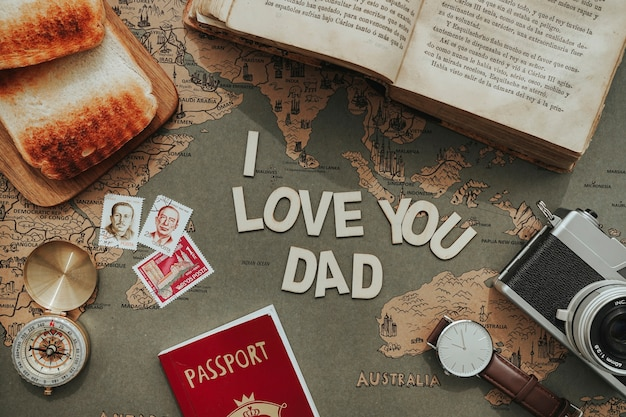 Passport, compass and other objects for father's day Free Photo