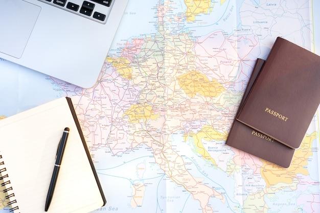Passport on europe map background. travel planning. Premium Photo