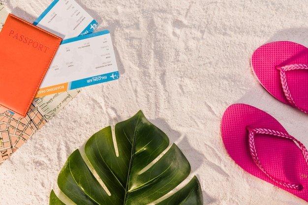 Passport and flip flops for beach vacation Free Photo
