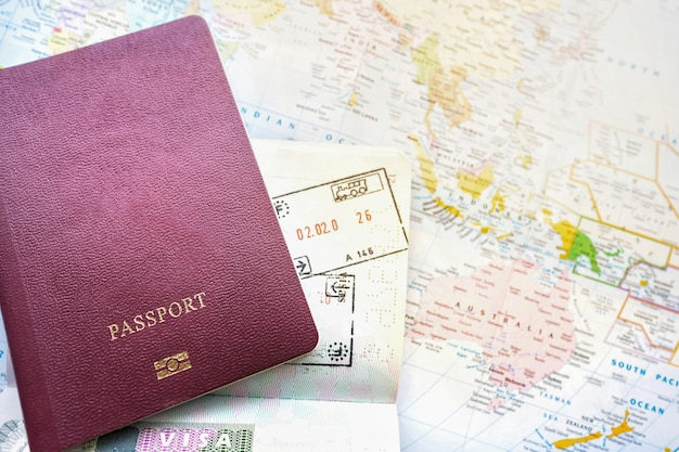 Passport on a map of the world.departure and arrival stamp with visa.traveling journey vacation holiday concept. Premium Photo