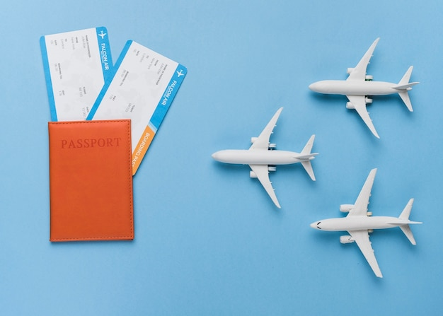 Passport, tickets and small airplanes Free Photo