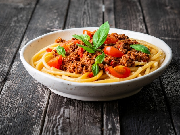 Pasta bolognese with tomato sauce, ground minced beef, basil leaf Premium Photo
