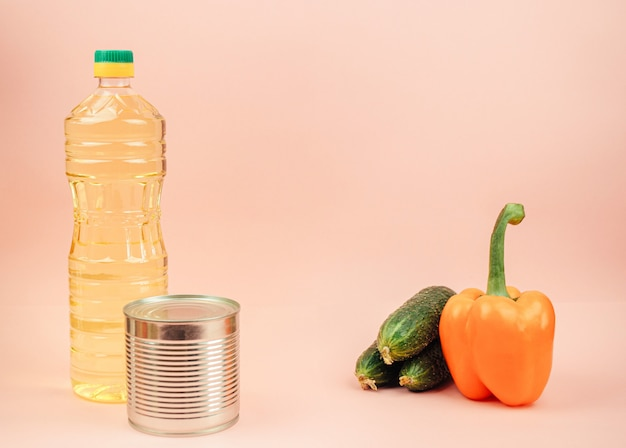 Pasta, canned food, cucumbers, butter, sweet pepper. the concept of food delivery, donation, charity. copyspace. Premium Photo